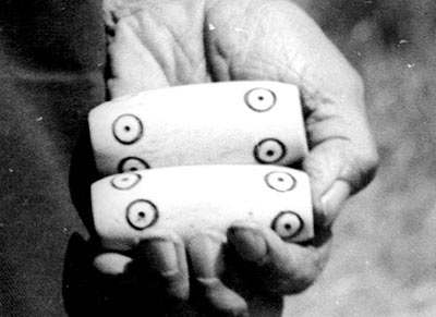 Suquamish game pieces made from decorated deer bone, Washington, 1947