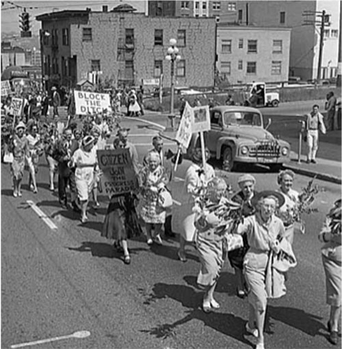 Protestors march across Spring Street demonstrating opposition to freeway construction, Seattle, June 1961 Courtesy Museum of History & Industry.